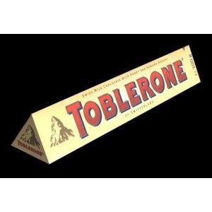 Шоколад Toblerone Swiss Milk Chocolate with Honey and Almond Nougat фото