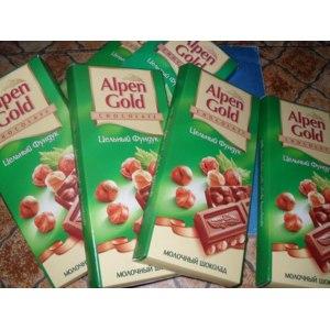 Шоколад Alpen Gold Молочный с цельным фундуком фото