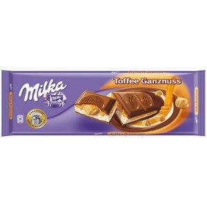 """Молочный шоколад Milka Toffee Ganznuss """"Цельный орех и карамель"""" фото"""