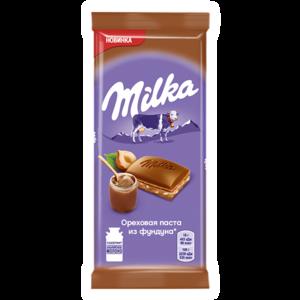 Шоколад молочный Milka ореховая паста из фундука фото