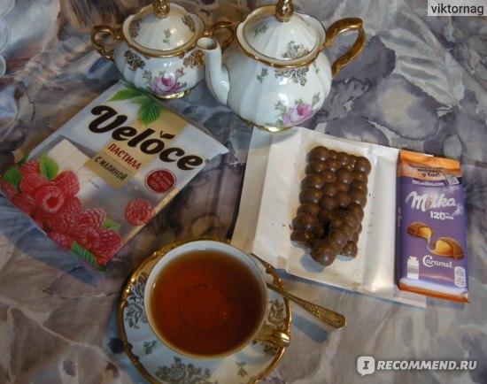 Молочный шоколад Milka Bubbles пористый  фото