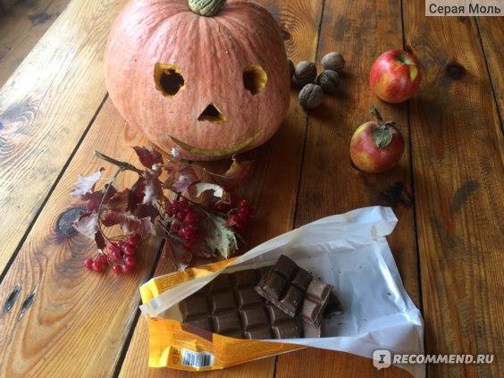 Продукт питания ROSHEN Lacmi  молочный шоколад с цельными лесными орехами  фото
