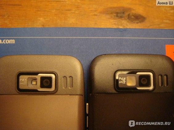 Слева новый телефон.