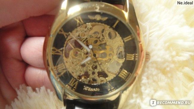 Часы женские Aliexpress GOLDEN BLACK SKELETON HAND WIND MECHANICAL MILITARY WATCH  фото