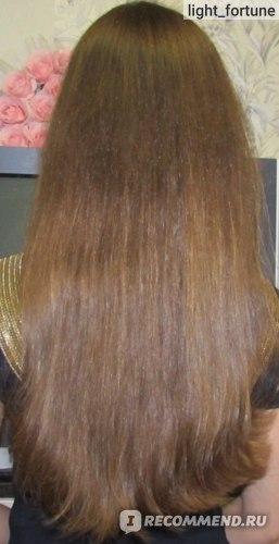 Вытягивание волос феном с помощью брашинга
