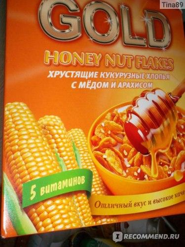 Готовые завтраки Nestle Хлопья Gold Flakes кукурузные с медом и арахисом фото