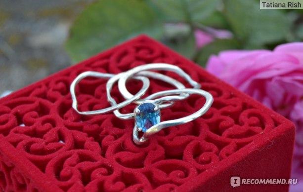 Кольцо головоломка Wickerring Серебряное с голубым Топазом фото