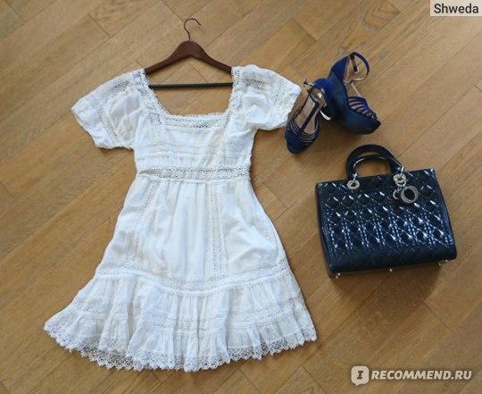 Тяжелая сумка с легким платьем