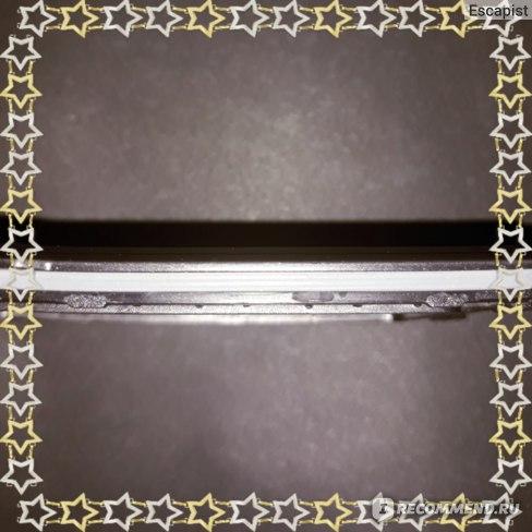 Белая резиновая прокладка на задней крышке