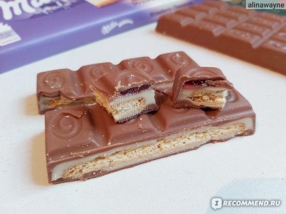 Молочный шоколад Milka Strawberry cheesecake со вкусом чизкейка, клубничной начинкой и печеньем  фото