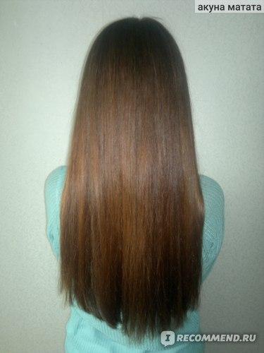 Волосы вытянуты феном.