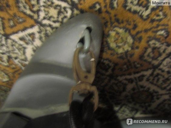 крепление эспандера к тренажеру, которое создает шум