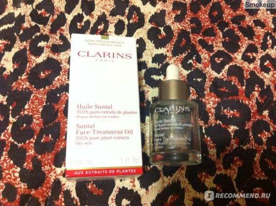 Масло косметическое Clarins Santal face treatment oil фото