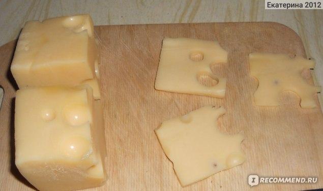 Сыр Новогрудские дары МК Maasdam Elite 45% фото