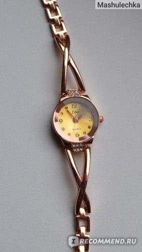 Часы женские Aliexpress 2015 New Fashion Women's Watch Slim Steel Band Royal Crystal Gold Watches Women Bracelet Casual Quartz Watch фото