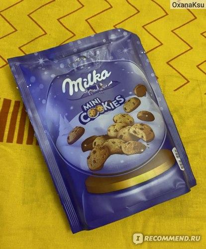 Печенье Milka Mini Cookies с кусочками шоколада, частично покрытое молочным шоколадом фото