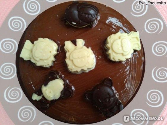 тортик, украшенный шоколадными зверюшками